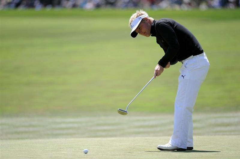 PEBBLE BEACH, CA - JUNE 19:  Soren Kjeldsen  of Denmark hits a putt on the first green during the third round of the 110th U.S. Open at Pebble Beach Golf Links on June 19, 2010 in Pebble Beach, California.  (Photo by Harry How/Getty Images)