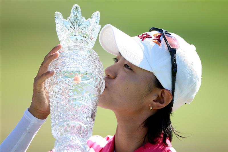 LA JOLLA, CA - SEPTEMBER 20:  Na Yeon Choi of South Korea kisses the winners trophy after her -16 under par victory during the final round of the LPGA Samsung World Championship on September 20, 2009 at Torrey Pines Golf Course in La Jolla, California.  (Photo By Donald Miralle/Getty Images)