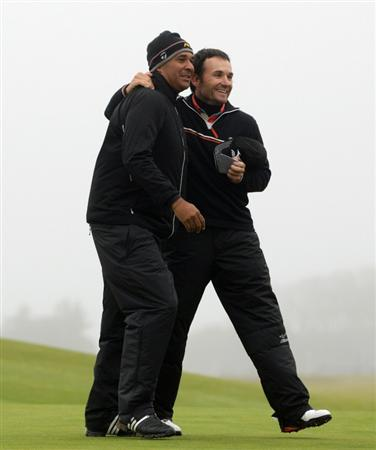 KINGSBARNS, SCOTLAND - OCTOBER 08: Ruud Gullit, former Dutch footballer,(left) and Ignacio Garrido of Spain in action during the second round of The Alfred Dunhill Links Championship at Kingsbarns Golf Links on October 8, 2010 in Kingsbarns, Scotland.  (Photo by Andrew Redington/Getty Images)