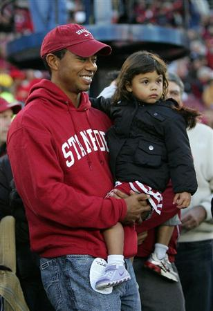 PALO ALTO, CA - NOVEMBER 21:  Honorary Standford Cardinal captain Tiger Woods holds his daugher, Sam, on the sidelines before the Cardinal game against the California Bears at Stanford Stadium on November 21, 2009 in Palo Alto, California.  (Photo by Ezra Shaw/Getty Images)