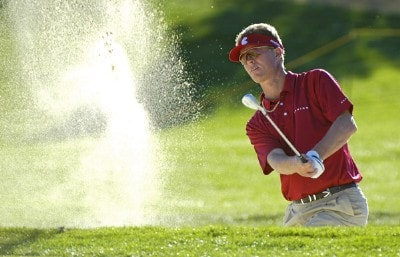 John Senden blasts out of the greenside bunker on the 16th hole during the third round of the Bob Hope Chrysler Classic at The Classic Club on Friday, January 20, 2006 in Palm Desert, California.Photo by Marc Feldman/WireImage.com