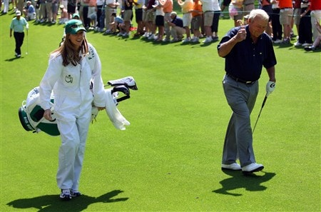 AUGUSTA, GA - APRIL 09:  Kelly Tilghman from The Golf Channel caddies for Arnold Palmer during the Par 3 Contest prior to the start of the 2008 Masters Tournament at Augusta National Golf Club on April 9, 2008 in Augusta, Georgia.  (Photo by Andrew Redington/Getty Images)