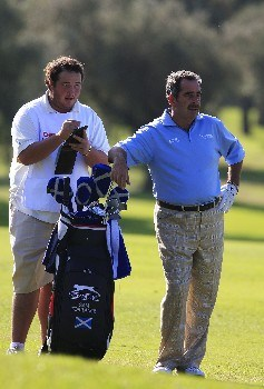 CASTELLON, SPAIN - OCTOBER 19:  Sam Torrance of Scotland with his son Daniel in action during the first round of the Oki Castellon Open de Espana Senior on October 19, 2007 in Castellon, Spain  (Photo by Phil Inglis/Getty Images)