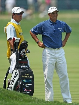 OAKMONT, PA - JUNE 17:  Tom Pernice Jr. discusses a shot with his caddie Brett Waldman during the final round of the 107th U.S. Open Championship at Oakmont Country Club on June 17, 2007 in Oakmont, Pennsylvania.  (Photo by David Cannon/Getty Images)