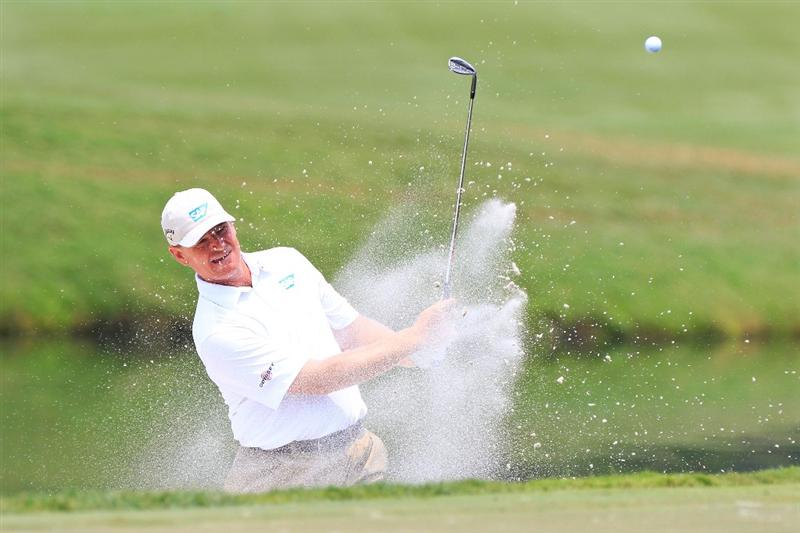 PONTE VEDRA BEACH, FL - MAY 11:  Ernie Els of South Africa hits from a bunker during a practice round prior to the start of THE PLAYERS Championship held at THE PLAYERS Stadium course at TPC Sawgrass on May 11, 2011 in Ponte Vedra Beach, Florida.  (Photo by Sam Greenwood/Getty Images)