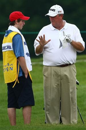 OAKVILLE, ONTARIO - JULY 25:  Mark Calcavecchia talks with his caddie, son Eric Calcavecchia as they wait to hit on the eighth fairway during round two of the RBC Canadian Open at Glen Abbey Golf Club on July 25, 2009 in Oakville, Ontario, Canada.  (Photo by Chris McGrath/Getty Images)