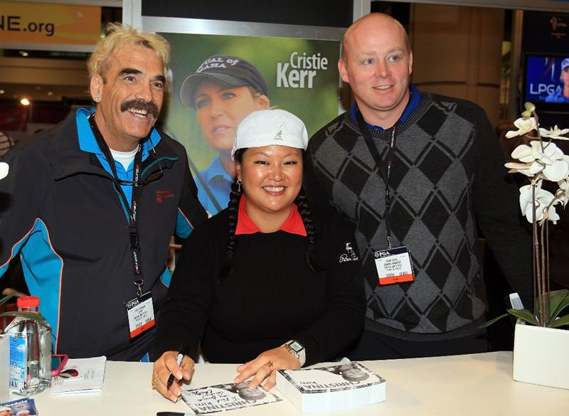 ORLANDO, FL - JANUARY 30:  LPGA fans pose with Christina Kim at the 2009 PGA Merchandise Show at the Orange County Convertion Center on January 30, 2009 in Orlando, Florida.  (Photo by Scott Halleran/Getty Images)