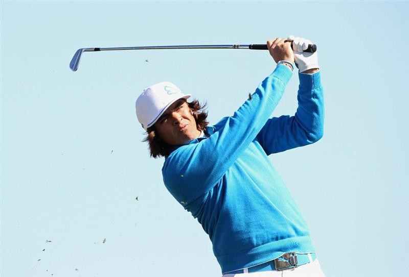 SCOTTSDALE, AZ - FEBRUARY 03:  Rickie Fowler hits a tee shot on the 12th hole during the first round of the Waste Management Phoenix Open at TPC Scottsdale on February 3, 2011 in Scottsdale, Arizona.  (Photo by Christian Petersen/Getty Images)