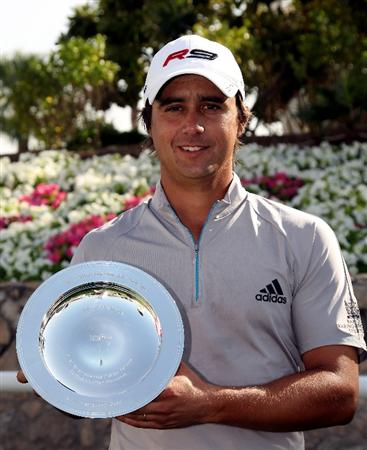 DUBAI, UNITED ARAB EMIRATES - FEBRUARY 03: Rafa Echenique of Argentina with The European Tour Shot of the Year trophy for 2009 pictured prior to the Omega Dubai Desert Classic on the Majlis Course at the Emirates Golf Club on February 3, 2010 in Dubai, United Arab Emirates.  (Photo by Ross Kinnaird/Getty Images)