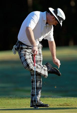 LAKE BUENA VISTA, FL - NOVEMBER 11:  Rory Sabbatini of South Africa cleans his shoes on the 12th hole during the first round of the Children's Miracle Network Classic at the Disney Palm and Magnolia courses on November 11, 2010 in Lake Buena Vista, Florida.  (Photo by Sam Greenwood/Getty Images)