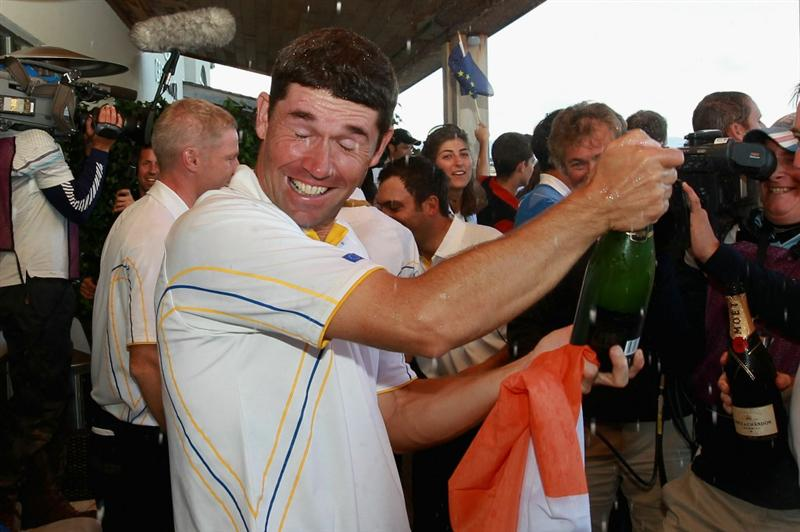 NEWPORT, WALES - OCTOBER 04:  Padraig Harrington of Europe sprays champagne on the balcony of the clubhouse following Europe's victory during the 2010 Ryder Cup at the Celtic Manor Resort on October 4, 2010 in Newport, Wales.  (Photo by Andrew Redington/Getty Images)