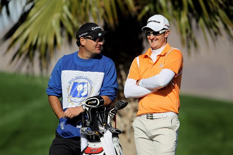 LA QUINTA, CA - JANUARY 20:  Justin Rose of England (R) and his caddie share a laugh while waiting on the 13th tee box during the first round of the Bob Hope Classic at the Silver Rock Resort on January 20, 2010 in La Quinta, California.  (Photo by Jeff Gross/Getty Images)