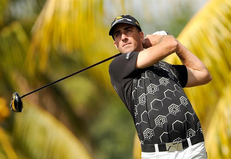 DORAL, FL - MARCH 12:  Geoff Ogilvy of Australia plays a shot on the 11th hole during the first round of the World Golf Championships-CA Championship at the Doral Golf Resort & Spa on March 12, 2009 in Miami, Florida.  (Photo by Sam Greenwood/Getty Images)