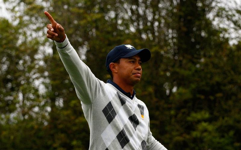SAN FRANCISCO - OCTOBER 10:  Tiger Woods of the USA Team points to the gallery on the third hole during the Day Three Morning Foursome Matches of The Presidents Cup at Harding Park Golf Course on October 10, 2009 in San Francisco, California.  (Photo by Scott Halleran/Getty Images)