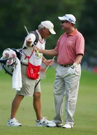 CROMWELL, CT - JUNE 25:  Joe Durant shares a laugh in the fairway with his caddie during the second round of the Travelers Championship held at TPC River Highlands on June 25, 2010 in Cromwell, Connecticut.  (Photo by Michael Cohen/Getty Images)