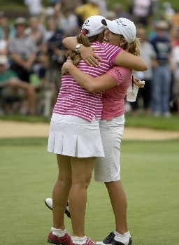 PORTLAND, OR - AUGUST 24: Cristie Kerr (R) is hugged by Kelli Kuehne after Kerr sank a birdie putt to win in a playoff at the 18th hole during the final round of the LPGA Safeway Classic at the Columbia Edgewater Country Club on August 24, 2008 in Portland, Oregon. (Photo by Steven Gibbons/Getty Images)