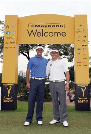 KUALA LUMPUR, MALAYSIA - APRIL 13:  Charl Schwartzel and Louis Oosthuizen of South Africa pose for a photo during a practice round ahead of the Maybank Malaysian Open at Kuala Lumpur Golf & Country Club on April 13, 2011 in Kuala Lumpur, Malaysia.  (Photo by Ian Walton/Getty Images)
