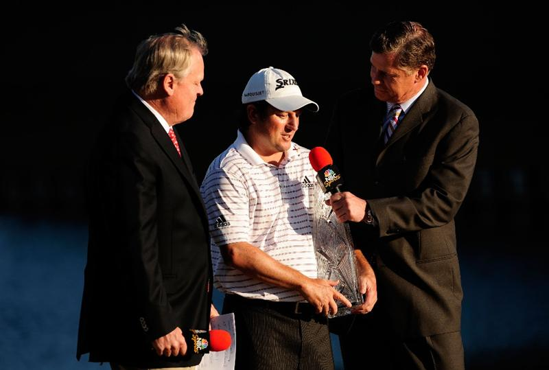 PONTE VEDRA BEACH, FL - MAY 09:  Johnny Miller (L) and Dan Patrick (R) of NBC award Tim Clark of South Africa the trophy during the trophy presentation after he won THE PLAYERS Championship held at THE PLAYERS Stadium course at TPC Sawgrass on May 9, 2010 in Ponte Vedra Beach, Florida.  (Photo by Sam Greenwood/Getty Images)