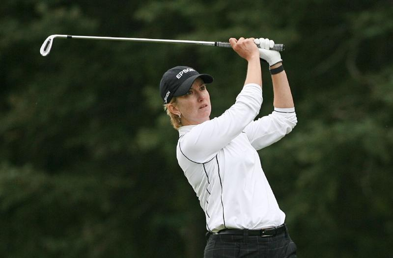 CALGARY, AB - SEPTEMBER 06 : Karrie Webb of Australia hits her second shot on the seventh hole during the final round of the Canadian Women's Open at Priddis Greens Golf & Country Club on September 6, 2009 in Calgary, Alberta, Canada. (Photo by Hunter Martin/Getty Images)