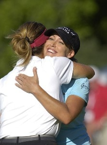 Cristie Kerr, winner of  the Canadian Women's Open, hugs Lorie Kane at the London Hunt and Country Club in London, Ontario on August 13, 2006.Photo by Steve Levin/WireImage.com