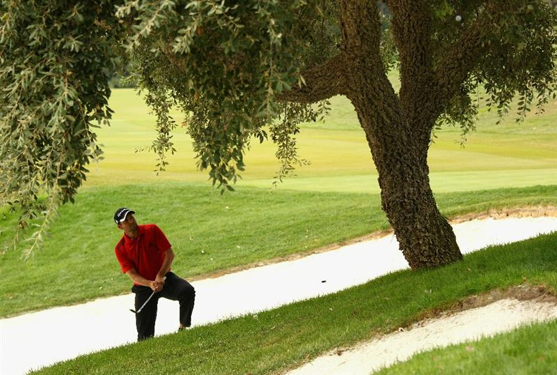 SOTOGRANDE, SPAIN - OCTOBER 29:  Sergio Garcia of Spain chips between the trunks of a tree onto the 5th green during the second round of the Andalucia Valderrama Masters at Club de Golf Valderrama on October 29, 2010 in Sotogrande, Spain.  (Photo by Richard Heathcote/Getty Images)