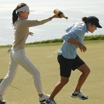 Hee-Won Han is doused with champagne by Soo-Yu Kang after Han's victory in the 2005 Office Depot Championship at Trump National Golf Club Los Angeles in Rancho Palos Verdes, California, September 3, 2005Photo by Steve Grayson/WireImage.com