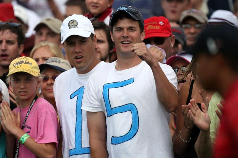 CHASKA, MN - AUGUST 16:  Golf fans watch as Tiger Woods walks to the first tee during the final round of the 91st PGA Championship at Hazeltine National Golf Club on August 16, 2009 in Chaska, Minnesota.  (Photo by David Cannon/Getty Images)
