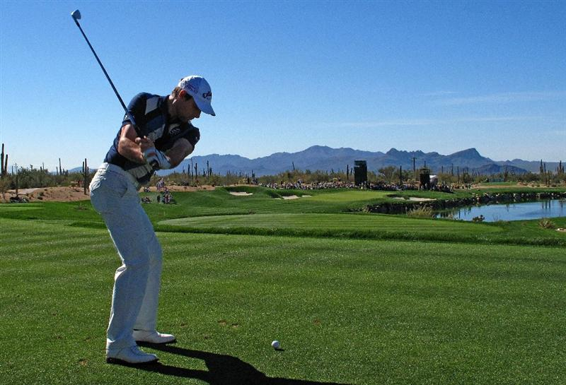 MARANA, AZ - FEBRUARY 26:  Oliver Wilson of England watches his third shot on the third hole during the second round of the Accenture Match Play Championship at the Ritz-Carlton Golf Club at Dove Mountain on February 26, 2009 in Marana, Arizona.  (Photo by Stuart Franklin/Getty Images)
