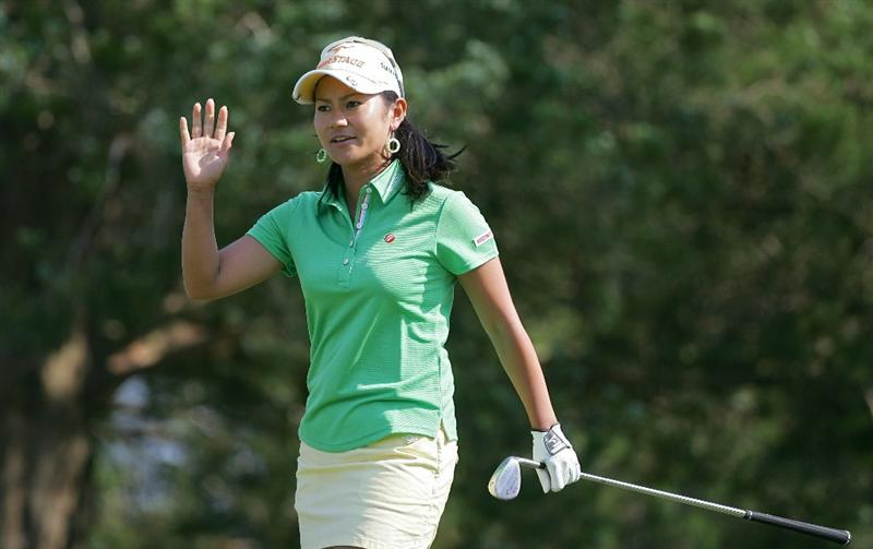 GALLOWAY, NJ - JUNE 19: Ai Miyazato of Japan acknowledges the gallery after her second shot on the seventh hole during the second round of the ShopRite LPGA Classic held at Dolce Seaview Resort (Bay Course) on June 19, 2010 in Galloway, New Jersey.  (Photo by Michael Cohen/Getty Images)