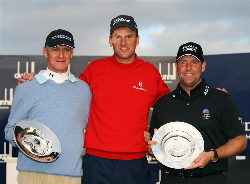 ST. ANDREWS, UNITED KINGDOM - OCTOBER 05: Championship winner Robert Karlsson (centre) togther with the team event winners John Bickerton (right) and Bruce Watson after The Alfred Dunhill Links Championship at The Old Course on October 5, 2008 in St.Andrews, Scotland. (Photo by Ross Kinnaird/Getty Images)