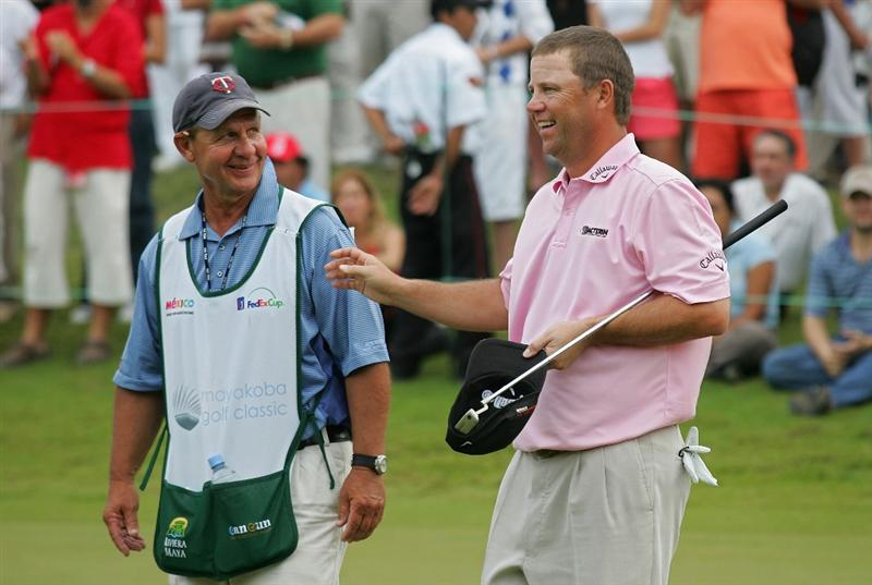 RIVIERA MAYA, MEXICO - FEBRUARY 21:  Cameron Beckman (right) celebrates with his caddie, John 'Cubby' Burke after winning the Mayakoba Golf Classic at El Camaleon Golf Club held on February 21, 2010 in Riviera Maya, Mexico.  (Photo by Michael Cohen/Getty Images)