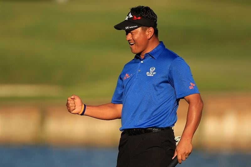 PONTE VEDRA BEACH, FL - MAY 15:  K.J. Choi of South Korea celebrates making birdie on the 17th hole during the final round of THE PLAYERS Championship held at THE PLAYERS Stadium course at TPC Sawgrass on May 15, 2011 in Ponte Vedra Beach, Florida.  (Photo by Streeter Lecka/Getty Images)