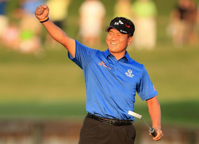PONTE VEDRA BEACH, FL - MAY 15:  K.J. Choi of South Korea celebrates making a par-saving putt to defeat David Toms on the first playoff hole during the final round of THE PLAYERS Championship held at THE PLAYERS Stadium course at TPC Sawgrass on May 15, 2011 in Ponte Vedra Beach, Florida.  (Photo by Streeter Lecka/Getty Images)