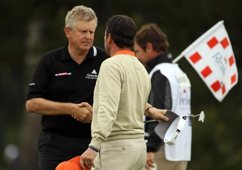 BARCELONA, SPAIN - MAY 07:  Colin Montgomerie of Scotland and Jose Maria Olazabal of Spain on the 18th green during the third round of the Open de Espana at the the Real Club de Golf El Prat on May 7 , 2011 in Barcelona, Spain.  (Photo by Ross Kinnaird/Getty Images)
