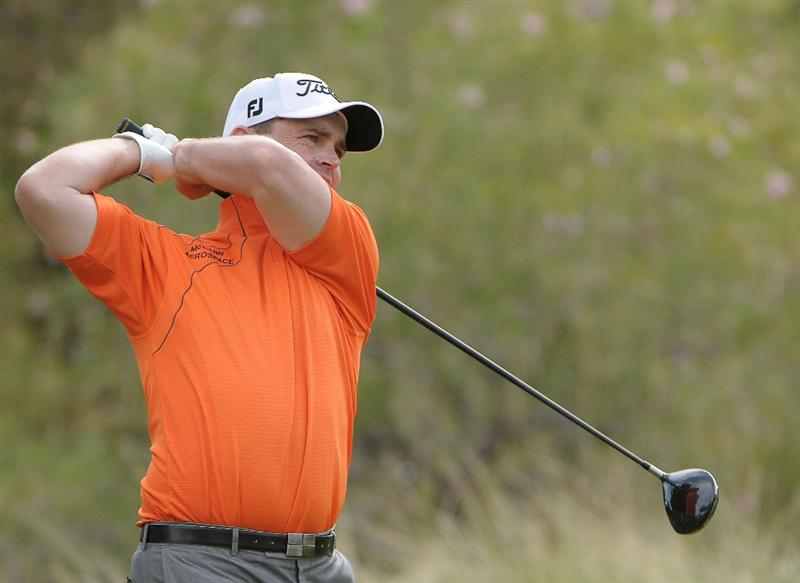 LAS VEGAS, NV- OCTOBER 18: Greg Chalmers of Australia tees off the 3rd hole during the fourth and final  round of the Justin Timberlake Shriners Hospitals for Childeren Open at the TPC Summerland on October 18, 2009  in Las Vegas, Nevada. (Photo by Marc Feldman/Getty Images)