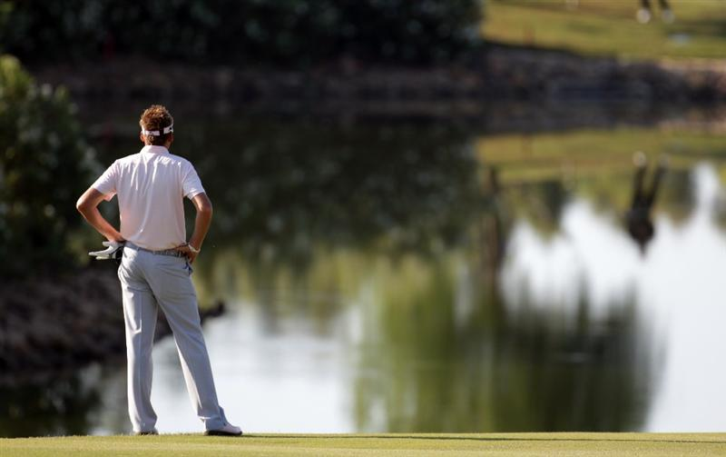 CASARES, SPAIN - MAY 22:  Ian Poulter of England waits to play his shot on the par five 3rd hole during the semi-final of the Volvo World Match Play Championship at Finca Cortesin on May 22, 2011 in Casares, Spain.  (Photo by Ross Kinnaird/Getty Images)