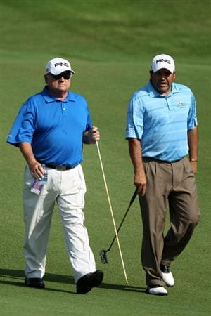 PONTE VEDRA BEACH, FL - MAY 04:  Angel Cabrera of Argentina (R) walks with his instructor Charlie Epps during a practice round prior to the start of THE PLAYERS Championship held at THE PLAYERS Stadium course at TPC Sawgrass on May 4, 2010 in Ponte Vedra Beach, Florida.  (Photo by Scott Halleran/Getty Images)