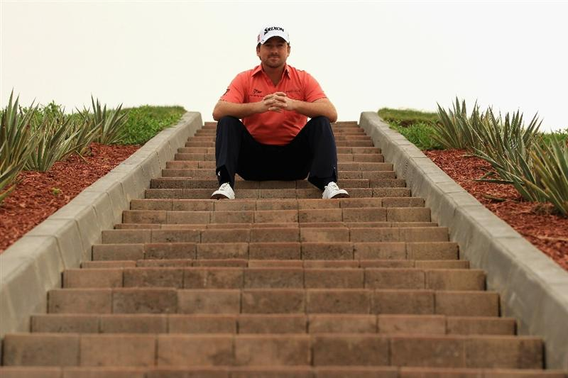 ABU DHABI, UNITED ARAB EMIRATES - JANUARY 19:  Graeme McDowell of Northern Ireland poses for a photograph during the Pro Am prior to the start of The Abu Dhabi HSBC Golf Championship at Abu Dhabi Golf Club on on January 19, 2011 in Abu Dhabi, United Arab Emirates.  (Photo by Andrew Redington/Getty Images)