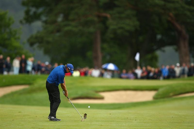 LUSS, UNITED KINGDOM - JULY 12:  Retief Goosen of South Africa plays his approach to the 1st hole during the Final Round of The Barclays Scottish Open at Loch Lomond Golf Club on July 12, 2009 in Luss, Scotland. (Photo by Richard Heathcote/Getty Images)
