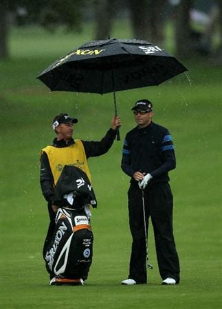 PACIFIC PALISADES, CA - FEBRUARY 18:  Robert Allenby of Australia stands under an umbrella held by caddie Colin Burwood on the second hole during round two of the Northern Trust Open at Riviera Country Club on February 18, 2011 in Pacific Palisades, California.  (Photo by Stephen Dunn/Getty Images)