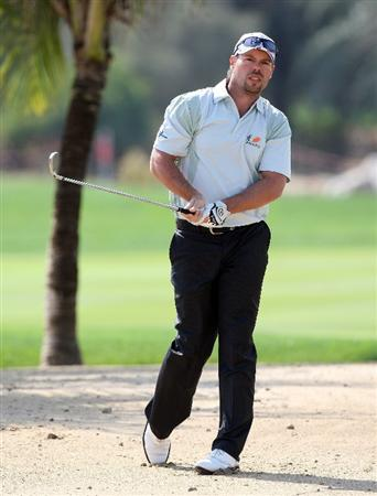 ABU DHABI, UNITED ARAB EMIRATES - JANUARY 15: Mikael Lundberg of Sweden plays his second shot at the 9th hole during the first round of the Abu Dhabi Golf Championship held at the Abu Dhabi Golf Club on January 15, 2009 in Abu Dhabi, United Arab Emirates  (Photo by David Cannon/Getty Images)