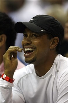 ORLANDO - APRIL 28: Professional Golfer Tiger Woods watches as the Toronto Raptors play the Orlando Magic in Game Five of the Eastern Conference Quarterfinals during the 2008 NBA Playoffs at Amway Arena on April 28, 2008 in Orlando, Florida. NOTE TO USER: User expressly acknowledges and agrees that, by downloading and or using this photograph, User is consenting to the terms and conditions of the Getty Images License Agreement. (Photo by Eliot J. Schechter/Getty Images)