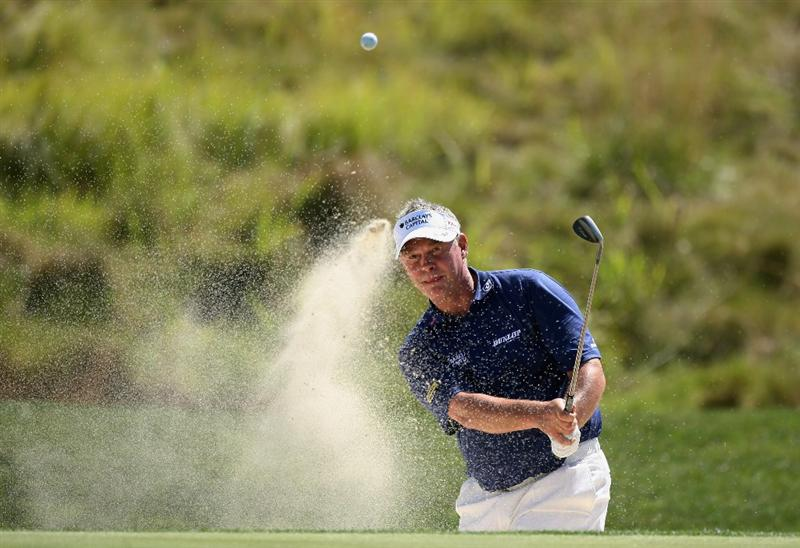 PAARL, SOUTH AFRICA - DECEMBER 16:  Darren Clarke of Northern Ireland plays out of the fifth greenside bunker during practice before the South African Open Championship at Pearl Valley Golf Club on December 16, 2008 in Paarl, South Africa.  (Photo by Warren Little/Getty Images)