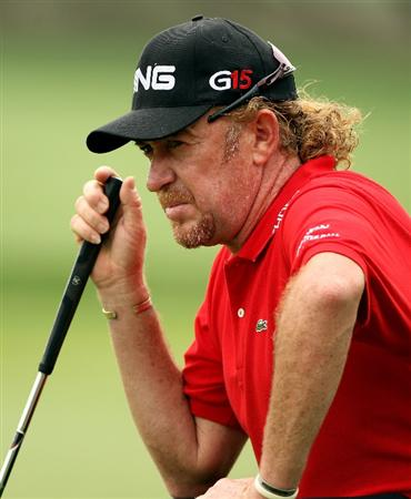 DUBAI, UNITED ARAB EMIRATES - FEBRUARY 06:  Miguel Angel Jimenez of Spain lines up a putt on the sixth hole during the third round of the Omega Dubai Desert Classic on February 6, 2010 in Dubai, United Arab Emirates.  (Photo by Andrew Redington/Getty Images)