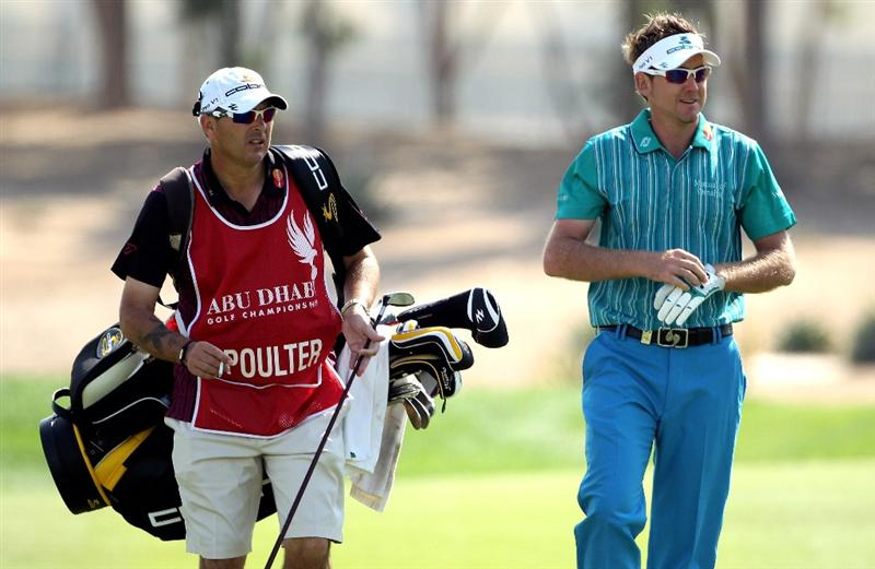 ABU DHABI, UNITED ARAB EMIRATES - JANUARY 23:  Ian Poulter of England shares a joke with his caddie Terry Mundy on the fifth hole during the third round of The Abu Dhabi Golf Championship at Abu Dhabi Golf Club on January 23, 2010 in Abu Dhabi, United Arab Emirates.  (Photo by Andrew Redington/Getty Images)