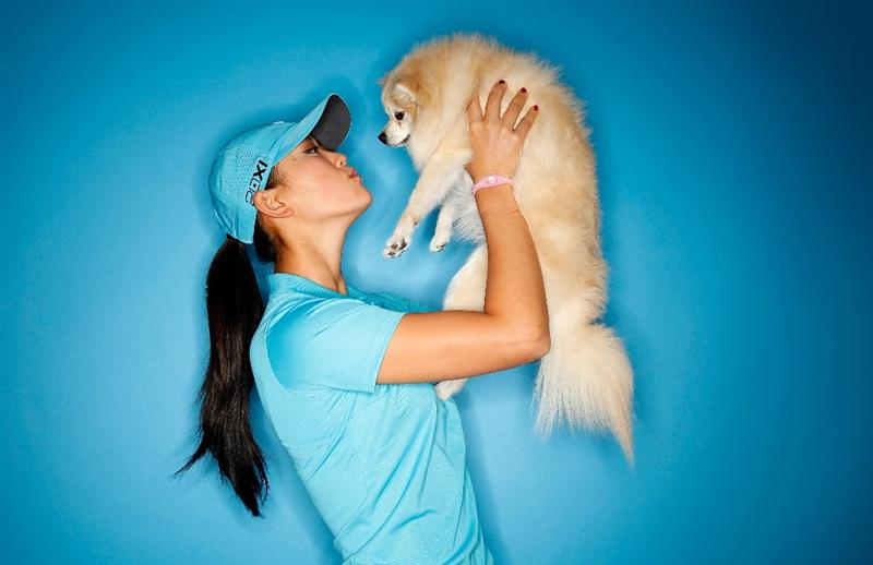 CITY OF INDUSTRY, CA - MARCH 22:  Michelle Wie poses for a portrait with her Pomeranian, Lola, on March 22, 2011 at the Industry Hills Golf Club in the City of Industry, California.  (Photo by Jonathan Ferrey/Getty Images)