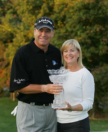 TIMONIUM, MD - OCTOBER 12: D.A. Weibring holds the trophy with his wife Kristy after winning the Constellation Energy Senior Players Championship at Baltimore Country Club East Course held on October 12, 2008 in Timonium, Maryland (Photo by Michael Cohen/Getty Images)