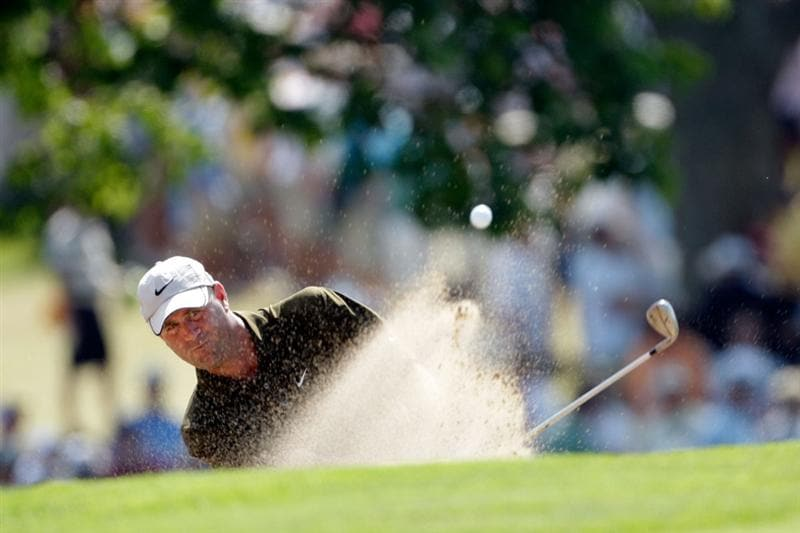 CHASKA, MN - AUGUST 14:  Stewart Cink hits a bunker shot on the 18th hole during the second round of the 91st PGA Championship at Hazeltine National Golf Club on August 14, 2009 in Chaska, Minnesota.  (Photo by Jamie Squire/Getty Images)