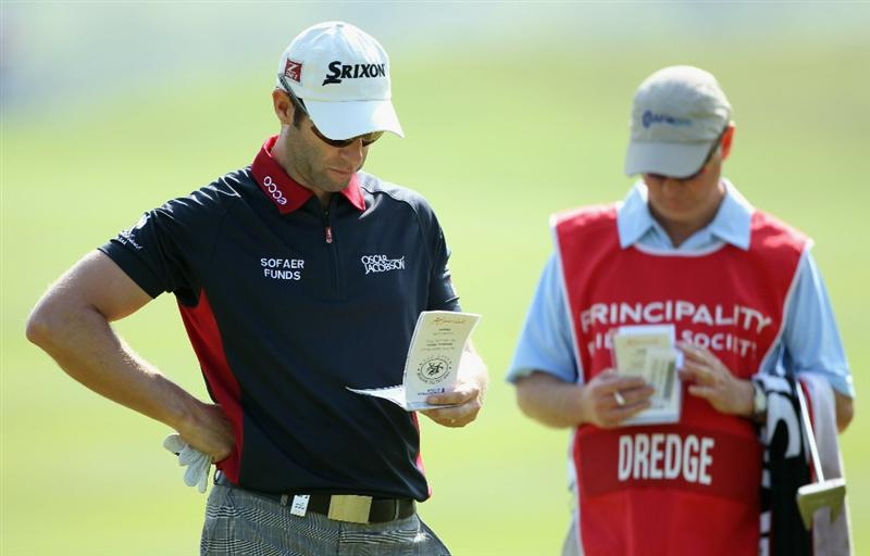 NEWPORT, WALES - JUNE 03:  Bradley Dredge of Wales and his caddie Nick Fidgeon check their yardage books on the 16th hole during the first round of the Celtic Manor Wales Open on The Twenty Ten Course at The Celtic Manor Resort on June 3, 2010 in Newport, Wales.  (Photo by Andrew Redington/Getty Images)