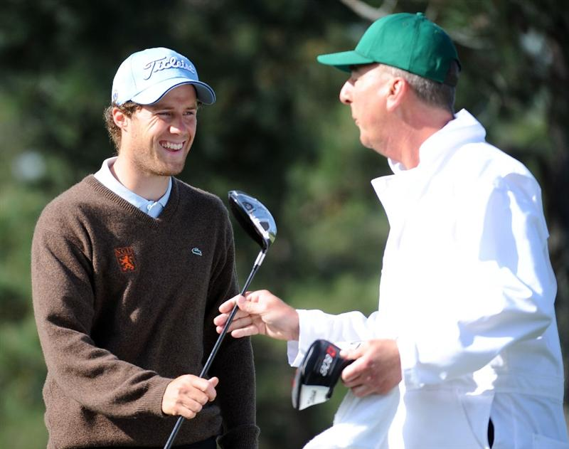 AUGUSTA, GA - APRIL 06:  Amateur Reinier Saxton of Holland hands a club off to his caddie during a practice round prior to the 2009 Masters Tournament at Augusta National Golf Club on April 6, 2009 in Augusta, Georgia.  (Photo by Harry How/Getty Images)